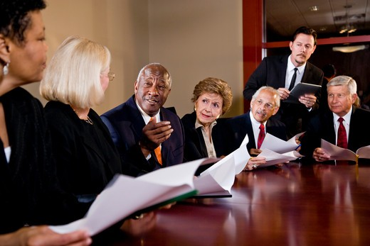 Manager presenting to group of senior executives : Stock Photo