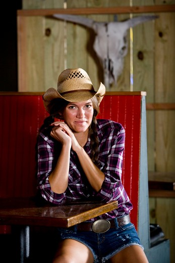 Stock Photo: 1785-42068 American girl wearing cowboy hat