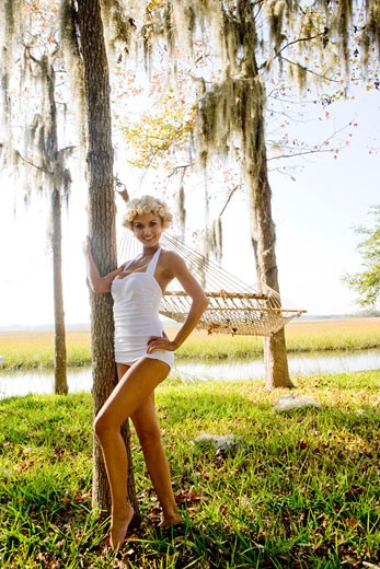 Stock Photo: 1785-9040 Sexy blonde woman in vintage bathing suit posing outdoors