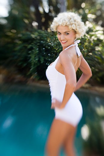 Portrait of happy blonde woman in vintage bathing suit : Stock Photo