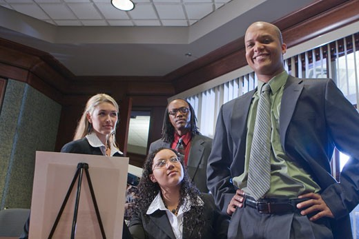 Multi-racial businesspeople meeting in boardroom watching presentation : Stock Photo