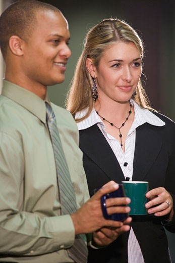Stock Photo: 1785-9443 Multi-racial office workers taking a coffee break