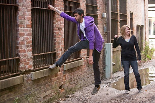 Stock Photo: 1785-9761 Young couple hanging out in alleyway having fun