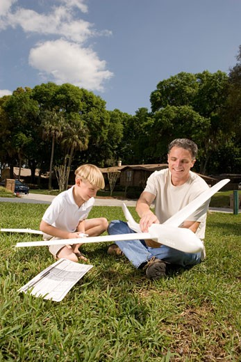 Stock Photo: 1785R-1681 Father and son with a toy glider