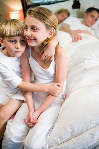 Children waiting for parents to wake up : Stock Photo
