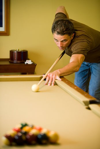 View of a man shooting pool : Stock Photo