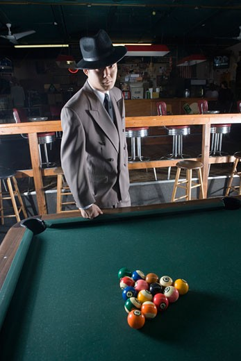 Gangster in a pool hall : Stock Photo