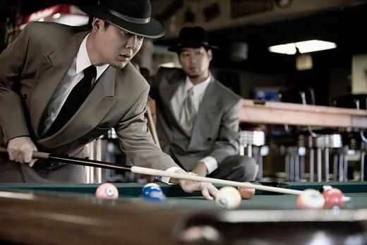 Two Asian men shooting pool : Stock Photo