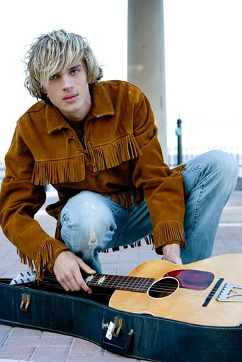 Young male hippie with guitar : Stock Photo