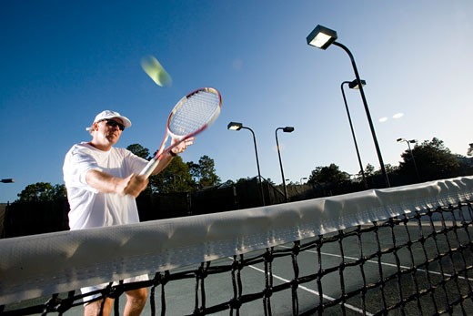 Tennis player hitting a volley : Stock Photo