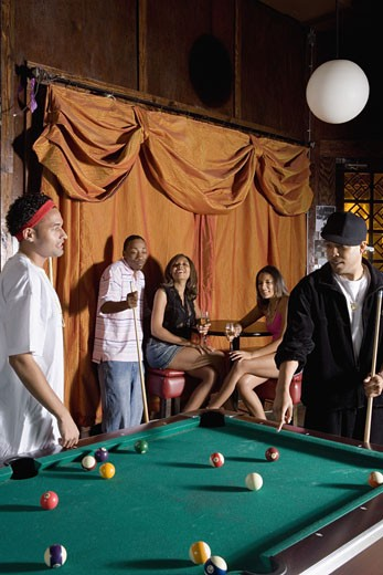 Stock Photo: 1785R-3049 Young men in hip-hop fashion shooting billiards