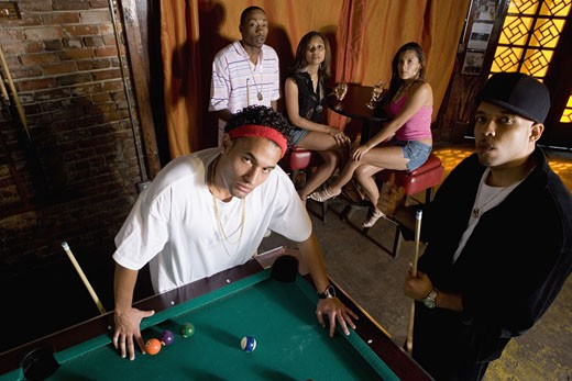 Stock Photo: 1785R-3053 Portrait of young men in hip-hop fashion leaning against pool table