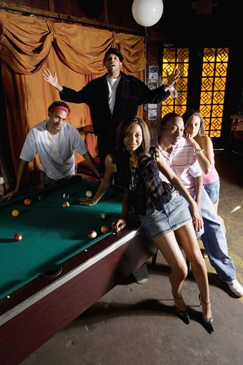 Stock Photo: 1785R-3072 Portrait of young men and women in hip-hop fashion hanging out by pool table