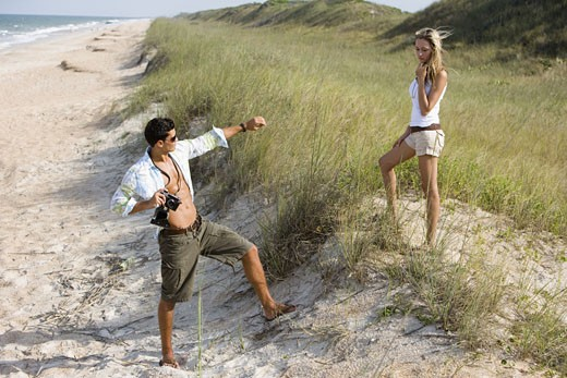 Stock Photo: 1785R-3789 View of a young couple at the beach