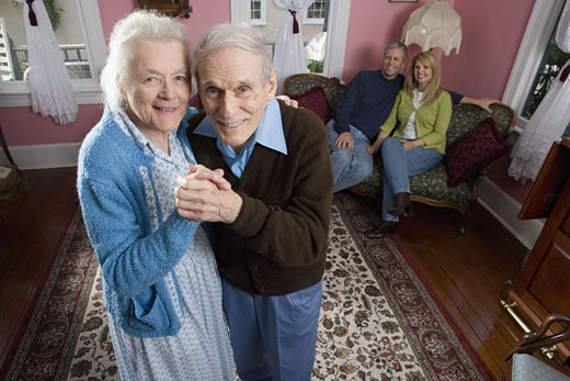 Senior couple dancing in living room : Stock Photo