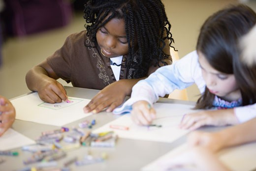 Stock Photo: 1785R-4389 Girls drawing with crayons in an art class