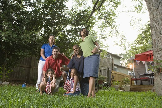 Stock Photo: 1785R-4728 Portrait of two families standing together in backyard of house