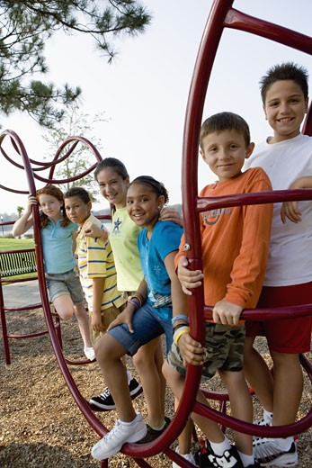 Stock Photo: 1785R-4822 Portrait of children climbing on monkey bars at a playground