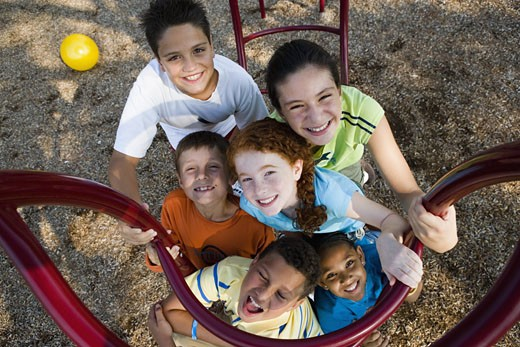Stock Photo: 1785R-4841 Portrait of children climbing on monkey bars at a playground