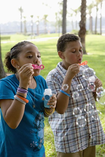Stock Photo: 1785R-4926 Children blowing bubbles at a park