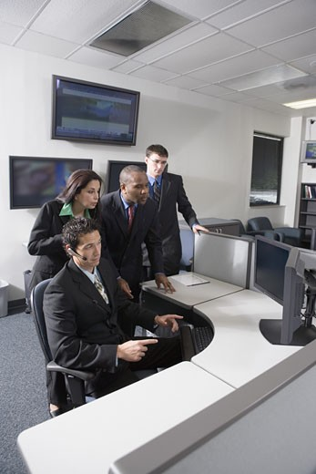 Business people working in a busy office : Stock Photo