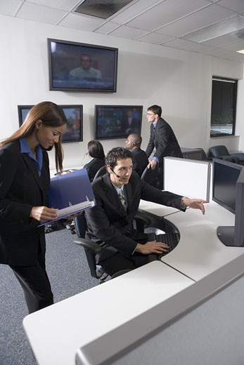 Stock Photo: 1785R-5340 Business people working together in a busy office