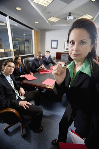 Stock Photo: 1785R-5417 Business men and women at a presentation in a formal conference room