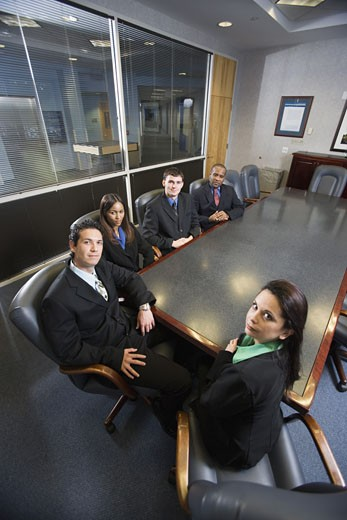Portrait of business executives in a formal conference room : Stock Photo