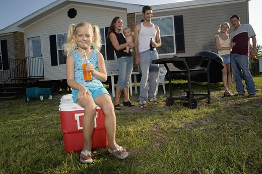Stock Photo: 1785R-5693 Blue collar families enjoying a cookout in front of trailer home