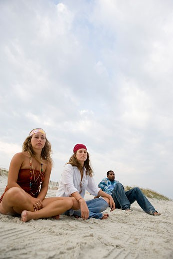 Hippies hanging out at the beach : Stock Photo