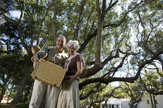 Mature couple going on a picnic : Stock Photo