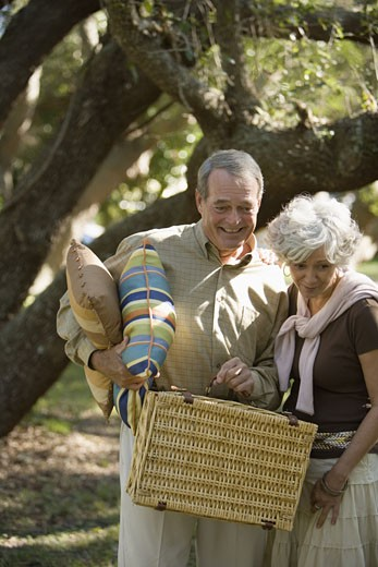 Close up of mature couple going on a picnic : Stock Photo