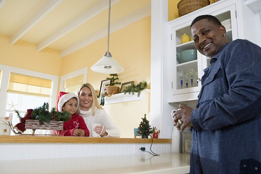 Low angle view of an inter-racial family in the kitchen : Stock Photo