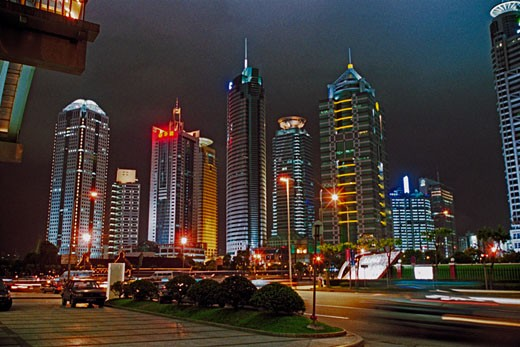 Low angle view of buildings at night, banking center of Pudong, Shanghai City of People's Republic of China : Stock Photo