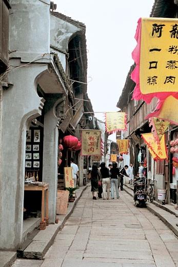 Stock Photo: 1787R-1156 People walking on street in market, Xitang Town, Jiashan County, Jiaxing City, Zhejiang Province, People's Republic of China,