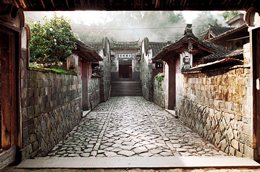 Stone-laid alley amid old houses, Taishun County, Zhejiang Province, People's Republic of China : Stock Photo