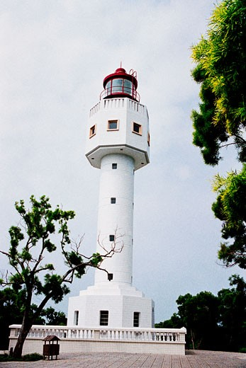 Low angle view of a beacon tower against sky, Weizhou island, Beihai City, Guangxi Zhuang Nationality Autonomous Region of People's Republic of China : Stock Photo