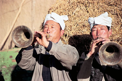 North Shanxi Men Playing Suona Horns, Yichuan County, Yan'an City, Shanxi Province, People's Republic of China, : Stock Photo