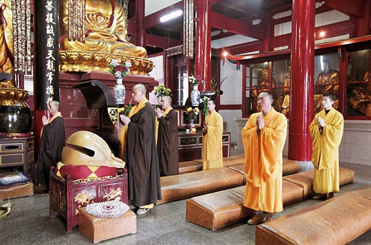 Monks praying in temple with hands joined, Linyang Temple, Lingtou Township, Fuzhou City, Fujian Province of People's Republic of China, : Stock Photo