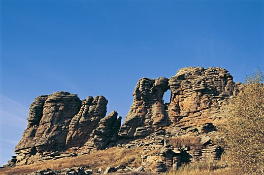 View of a rock formation against blue sky, Arab League Si Hatu hoodoo of World geology park, Keshiketengqi, Chifeng City Inner Mongolia Autonomous Region of People's Republic of China : Stock Photo