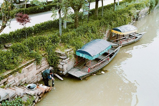 Woman washing clothes in Xiangxi river in old Mudu Town, Suzhou City, Jiangsu Province of People's Republic of China, : Stock Photo