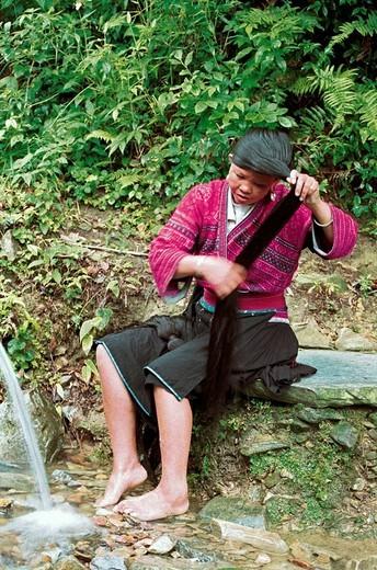 Hongyao minority long_haired woman combing, Longji mountain, Longsheng County, Guilin City, Guangxi Zhuang Nationality Autonomous Region of People's Republic of China, : Stock Photo