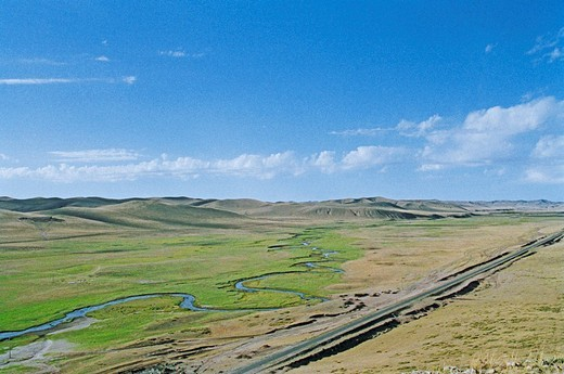 Elevated view of meandering stream passing through grassland in Gonggeer, Keshiketengqi, Chifeng City Inner Mongolia Autonomous Region of People's Republic of China : Stock Photo