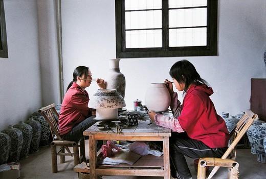 Women workers painting ceramics, Jingde town, Jiangxi Province of People's Republic of China, : Stock Photo