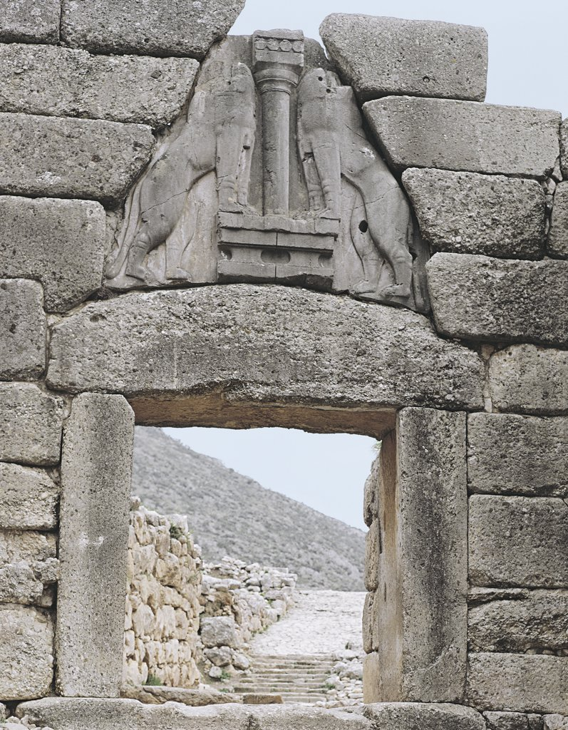 Stock Photo: 1788-1086 Carvings of two lions above a window of an ancient building, Lions Gate, Mycenae, Greece