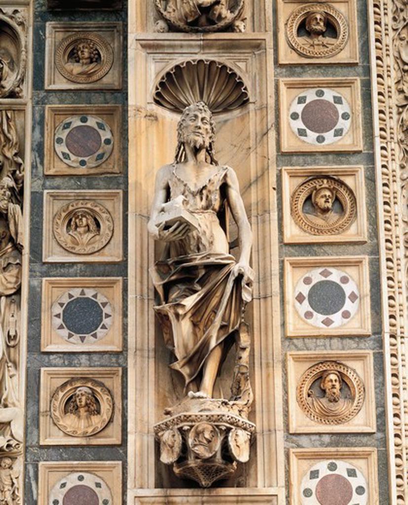 Stock Photo: 1788-11761 Italy, Lombardy, Pavia Charterhouse (Certosa), facade, statue of Saint John the Baptist, attributed to Tamagnino