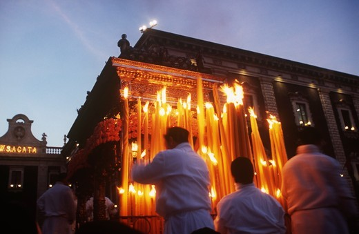 "Stock Photo: 1788-12067 Italy, Sicily region, Festival of Saint Agatha, devotees light candles on the """"Fercolo"""""