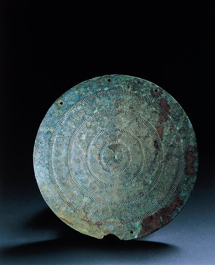 Italy, Prehistory, Iron Age, Disc for cuirass armor, From Moie di Pollenza (Macerata Province) : Stock Photo