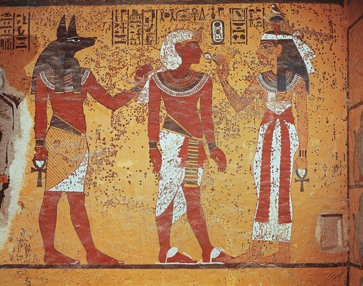 Stock Photo: 1788-15124 Egypt, Thebes, Luxor, Valley of the Kings, Tomb of Tutankhamen, burial chamber, detail of mural paintings. In the presence of Anubis, pharaoh receives symbol of eternal life 'ankh' from sky goddess Hathor