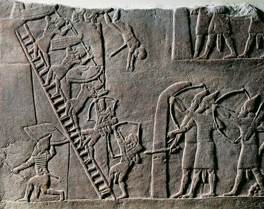 Detail of relief showing soldiers using ladders to scale walls and capture Ethiopians from Egyptian city, from ancient Nineveh, Iraq : Stock Photo
